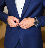 Getting ready for new working day. Young man dressing up his jacket Stock Photo