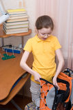 Getting ready for school. Nine year old girl packing her schoolbag royalty free stock image