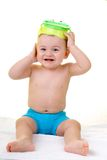 Getting ready for the summer. Baby in swimsuit putting the mask on royalty free stock images