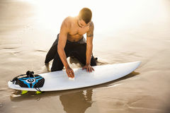 Getting ready for surf. A surfer getting ready for the surf Royalty Free Stock Images