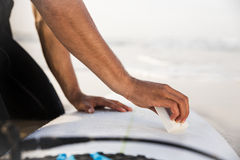 Getting ready for surf. A surfer getting ready for the surf Royalty Free Stock Photo