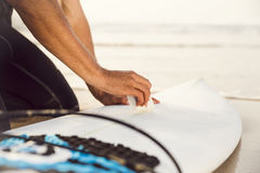 Getting ready for surf. A surfer getting ready for the surf Stock Photography