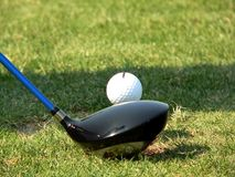 Getting Ready to Hit. A driver and golf ball closeup Stock Photo