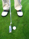 Getting ready to putt. Shot of golfers shoes, iron& ball...ready to go for the putt Stock Photography