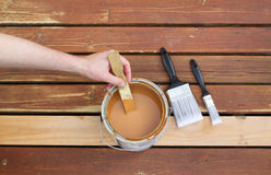 Getting ready to stain wooded outdoor deck Royalty Free Stock Photo