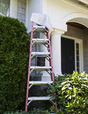 Getting ready to touch up white trim on house Stock Image