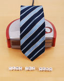 Getting Ready To Work. Alarm Clock Covered With Mens Tie Royalty Free Stock Photos