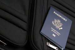 Getting ready for the trip. Passport on a suitcase to show packing for a trip royalty free stock image