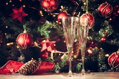 Getting ready! Two empty glasses with Christmas tree background. Stock Photography