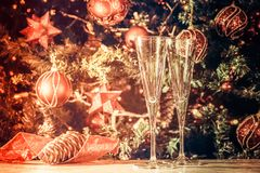 Getting ready! Two empty glasses with Christmas tree background Stock Image