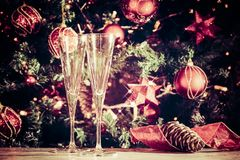 Getting ready! Two empty glasses with Christmas tree background Stock Photos