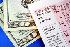 Getting refund from the income tax return Stock Image