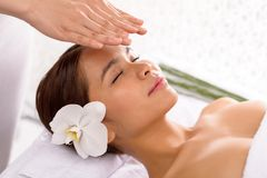 Getting reiki therapy. Peaceful girl getting reiki therapy royalty free stock image