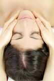 Getting relaxing massage in spa Royalty Free Stock Images