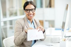 Getting salary. Happy businesswoman getting salary for her work stock images