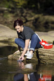 Getting a sample. Biologist get a water sample for the river stock photography