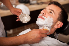 Getting shaved in a barber shop Royalty Free Stock Images
