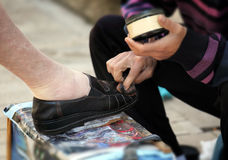Getting a shoe shine Royalty Free Stock Photo