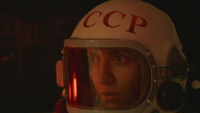Getting Sick Cosmonaut. A retro soviet cosmonaut (USSR or CCCP, THE Soviet Union abreviation) is getting sick, due the lack of oxygen and loose of pressure on stock video footage