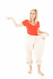 Getting slim young woman pointing ahead Royalty Free Stock Photos