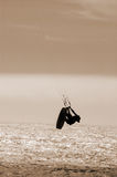 Getting some air, sepia version. A parasurfer getting some air near Santa Cruz, California Royalty Free Stock Image