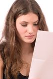 Getting some bad news. Pretty teenager reading a letter with bad news royalty free stock photos
