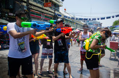 Getting sprayed at Songkran. Bangkok, Thailand, 15 April 2015. Festival goers at Khao San Road spraying each other with water guns during the annual Songkran royalty free stock photo