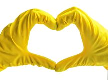 Getting started cleaning. Yellow rubber gloves for cleaning on white background .General or regular cleanup. Commercial cleaning company. Copy space. Empty stock image