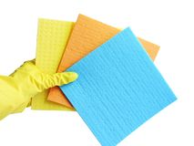 Getting started cleaning. Yellow rubber gloves for cleaning on white background .General or regular cleanup. Commercial cleaning company. Copy space. Empty royalty free stock images
