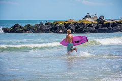 Getting In the Surf Royalty Free Stock Images