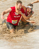 Getting tacled in the mud Royalty Free Stock Images