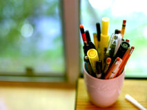Getting to work. A cup of pencils and pens royalty free stock photos