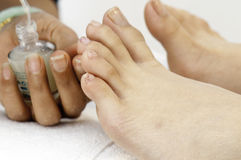 Getting the Toes Painted Royalty Free Stock Images