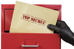 Getting top secret documents from a red file cabinet, over a white background. Royalty