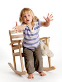 Getting up from armchair little girl Royalty Free Stock Photography