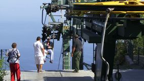 Getting up to the top of Capri chair lift. Chair lift to the top of Capri stock video