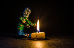 Getting warm by a candle Stock Image