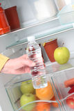 Getting Water from Fridge Stock Photo