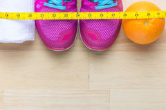Free Getting Wellness Body Woman With Measuring Tape, Orange, Sportwear And White Towel View From The Top. Fitness Concept Royalty Free Stock Image - 70501586