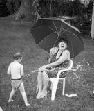 Getting wet in the rain. Royalty Free Stock Images