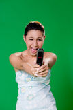 Getting at your mobile phone. Young mobile getting mad her mobile phone Stock Image
