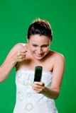 Getting at your mobile phone. Young mobile getting mad her mobile phone Royalty Free Stock Photography