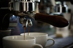 Getting Your Perfect Drink. Coffee Being Brewed In Coffeehouse Or Cafe. Coffee Cups. Small Cups To Serve Hot Coffee Stock Image
