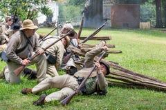 Gettysburg Battle Reenactment. HUNTERSVILLE, NC - July 1, 2017: Military reenactors in Confederate uniforms recreate the American Civil War Battle of Gettysburg royalty free stock photos