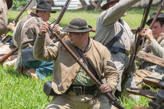 Gettysburg Battle Reenactment. HUNTERSVILLE, NC - July 1, 2017: Military reenactors in Confederate uniforms recreate the American Civil War Battle of Gettysburg stock images