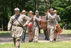 Gettysburg Battle Reenactment. HUNTERSVILLE, NC - July 1, 2017:  Military reenactors in Confederate uniforms recreate the American Civil War Battle of Gettysburg Stock Photo