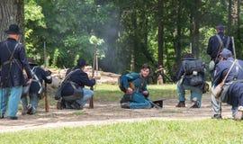 Gettysburg Battle Reenactment. HUNTERSVILLE, NC - July 1, 2017:  Military reenactors in Union uniforms recreate the American Civil War Battle of Gettysburg at Royalty Free Stock Image