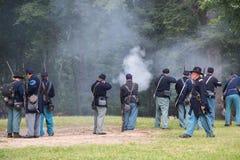 Gettysburg Battle Reenactment. HUNTERSVILLE, NC - July 1, 2017:  Military reenactors in Union uniforms recreate the American Civil War Battle of Gettysburg at Stock Images