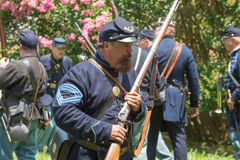 Gettysburg Battle Reenactment. HUNTERSVILLE, NC - July 1, 2017:  Military reenactors in Union uniforms recreate the American Civil War Battle of Gettysburg at Royalty Free Stock Photos