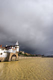 Getxo seafront and Arriluze lighthouse with stormy weather Stock Photos